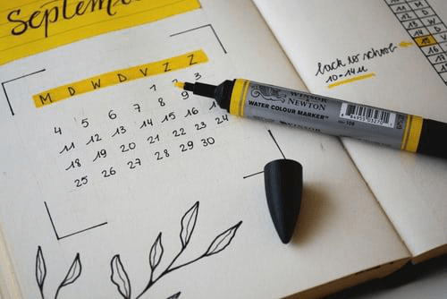 Use a day planner or calendar